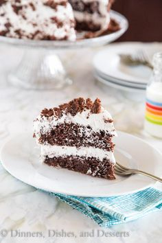 """Chocolate Cream Cake - Moist chocolate cake topped with a light and fluffy almond flavored whipped cream """"frosting"""".(use cocnut whipped topping)"""
