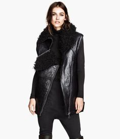 Leather Vest, Long leather vest with a crackled finish and imitation sheepskin lining. Zip at collar and diagonal zip at front. Side pockets, one chest pocket with zip, and adjustable tabs with metal buckles at sides. | H&M US