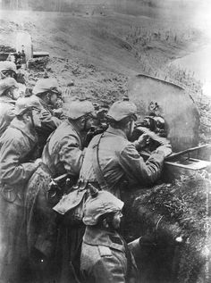 1915: German soldiers operating a machine gun from a trench on Russia's Eastern Front