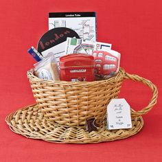 "This ""London"" theme basket is so easy to put together for any city. Grab a few fun items from the local tourist shop and a map of the local transportation."