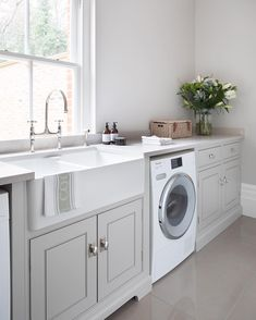 Love the cabinet colors The Spenlow laundry room at the Epping Forest project has a double butler sink with the Ionian tap with rinse by Perrin & Rowe and Miele washing machine and dryer either side. Opposite is a long run of tall Spenlow cupboards with a mix of shelving and drying space for laundry.