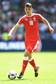Granit Xhaka Photos - Granit Xhaka of Switzerland in action during the UEFA EURO 2016 round of 16 match between Switzerland and Poland at Stade Geoffroy-Guichard on June 2016 in Saint-Etienne, France. - Switzerland v Poland - Round of UEFA Euro 2016 Granit Xhaka, Uefa Euro 2016, Saint Etienne, European Championships, Gareth Bale, Football Players, Switzerland, Poland, June