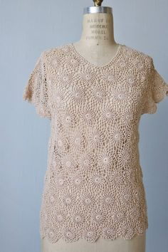 Vintage 1970s crochet sweater top in nude with a scoop neckline, scalloped cap sleeves and a scalloped bottom edge. --- M E A S U R E M E N T S ---  Bust: 35 Length: 26 Shoulder: would best fit a 15 to 16.5 shoulder width. Sleeve: short cap like sleeve overhang Label/ Era: Le Roy Knitwear /1970s Fabric:acrylic Vintage Condition: Excellent  ★ Shop more lovely blouses and skirts here: http://www.etsy.com/shop/thevintagemistress?section_id=5922192  ★ 25% off an...