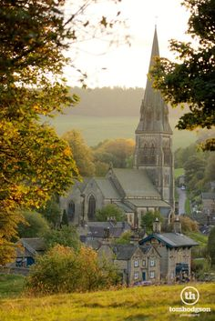 England Travel Inspiration - Whilst on the way through Chatsworth Park one autumn afternoon I noticed a lovely warm haze surrounding the village of Edensor and captured the view towards the church from beneath the trees overlooking Chatsworth House. From £7