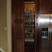 Custom pantry doors which match kitchen cabinetry, concealing a walk-in pantry. Professionally designed, and installed by American craftsmen who are respectful and courteous to our clients. Prices are low, and all cabinetry comes with a lifetime warranty. Call (205) 902-1102 today for a free in-home consultation and estimate!