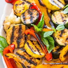 This is my idea of a summer dinner.Loads of grilled veggies, simply tossed with olive oil, salt, and pepper, and an easy vinaigrette that's exploding with flavor. The dressing comes together in one minute in a blender or food processor and tastes like a beautiful basil bomb exploded in your mouth. I mean that in …