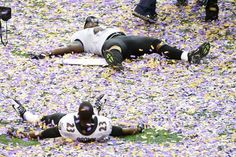 Moment of elation... Baltimore Ravens fullback Vonta Leach (top) and defensive back Chykie Brown (23) celebrate after defeating the San Francisco 49ers 34-31.