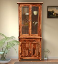 Buy Louis Solid Wood Hutch Cabinet in Rustic Teak Finish by Amberville Online: Shop from wide range of Hutch Cabinets Online in India at best prices. Hutch Cabinet, Cabinet Furniture, Wooden Storage Boxes, Storage Ideas, Indian Homes, Selling Furniture, Solid Wood Furniture, Teak, Craftsman