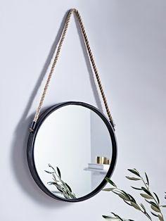black small hallway accessories, round mirror