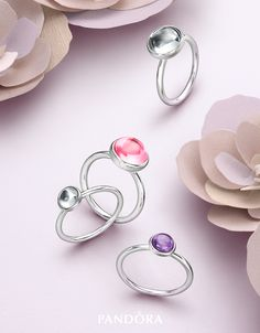Sneak peek! The inspiration for the Poetic Droplets rings from PANDORA's Spring collection 2016 is taken from dew drops on pastel blooms. When looking through the dew drop, the color of the flower is reflected as is the structure of the flower petal. The stackable rings will bring a splash of bright hues to your collection. #PANDORAring