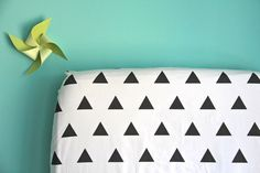 fitted crib sheet in black triangles (exclusive to iviebaby). $55.00, via Etsy.