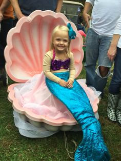 Homemade DIY Halloween costume. Mermaid in a clam shell.