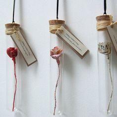 Handmade Paper Rose In A Glass Vial from notonthehighstreet.com