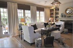 from Cote de Texas, wall-mounted bamboo roman shades with the drapes hanging in front