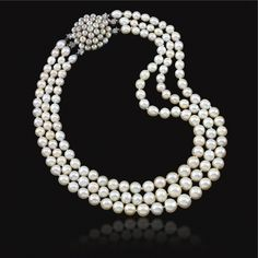 PROPERTY OF MARCHESA LUCIA MISCIATTELLI Pearl and diamond necklace, Cartier, 1960s.  Designed as three rows of forty-four, forty-nine and fifty-one pearls, on a circular pearl clasp, each pearl embellished with a single-cut diamond collet,