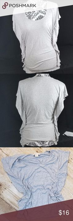 """Michael Kors Top . Grey Michael Kors Top with Ruffled accents on both sides . Very stretchy . Size Medium / Length 24"""" / Chest 13.5"""" Michael Kors Tops Tees - Short Sleeve"""