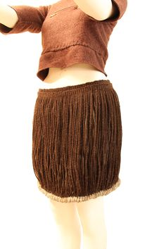Museum quality reproduction of Bronze Age costume, female. Clothing based on those from Danish oak coffins. Cord skirt made from genuine Norwegean wild sheep wool. Textile, bronze and leather by Ø. Engedal. www.arkeoreplika.no, www.bronsereplika.no