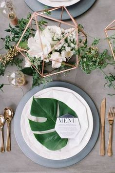 Summer Table Decorating Ideas gray table with palm leaf
