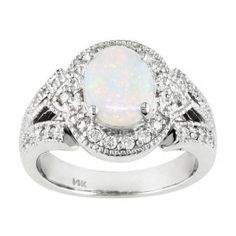 My birthstone is opal. If my future fiancé is smart this would be a perfect engagement ring!