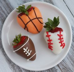 Wiltons chocolate covered strawberries painted to look like a basketball, baseball, and football with icing