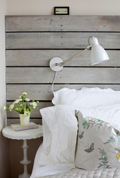 reclaimed wood headboard--w/ ikea lamps? palet wood or tounge and groove.