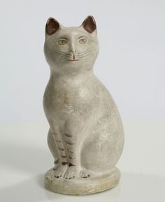 PAINT-DECORATED CHALKWARE SEATED CAT - American, 19th century.