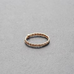 MOUNT LAVINIA BRAIDED RING ROSE GOLD // Braided, matt-finished rose gold-plated sterling silver ring. // The simple, yet substantial Mount Lavinia collection comprises fine rings featuring different designs and a variety of precious metals. Wear them alone or combine them with something from your jewelry box, or other rings of the Mount Lavinia collection. shop.kinsfo.lk