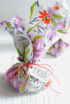 Simple gift wrapping with fabric scraps. No sewing - just using pinking shears to make an edge. | Project Wedding http://www.projectwedding.com/blog/2011/04/05/diy-surprise-wildflower-seed-favors/