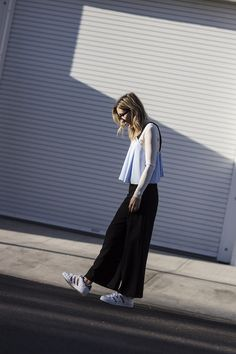 Le Fashion Blog Layering Baby Doll Tank Shirt Over White Long Sleeved T Shirt Black Wide Leg Pants White Sneakers Via The Fashion Sight