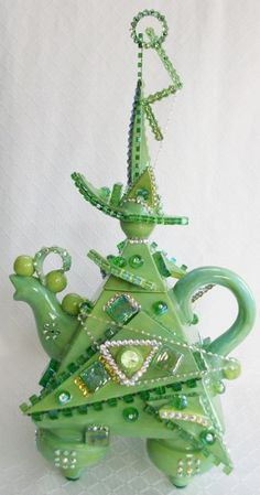"Emerald City Teapot 9""W x 17""H, over 1100 Swarovski crystals plus acrylic forms."