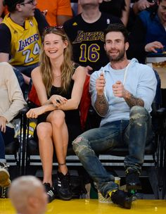 Adam Levine & Behati Prinsloo Make Out on Lakers Kiss Cam!: Photo Adam Levine plants a big fat kiss on his wife Behati Prinsloo while getting caught on the kiss cam at the Los Angeles Lakers game on Sunday evening (November Maroon 5, Adam Levine Behati Prinsloo, The Voice, Adam And Behati, Kiss Cam, Lakers Game, Pulsar, Gal Pal, Blue Hoodie