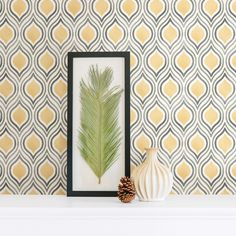Plume is a lovely watercolour geometric retro design in mustard yellow and grey on a white background. This design has a Moroccan feel too it. It's paste the too, making it quick and easy to hang.