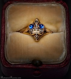 A VERY RARE Russian Imperial Presentation Gem-Set Gold Ring in its original red leather case ~ An openwork 14K gold ring is decorated with the Russian Imperial crown, made in St. Petersburg between 1899 and 1903. Attributed to Faberge. The crown is set with two cabochon cut sapphires and ten rose cut diamonds ~