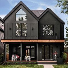 Delightful dark modern two story farmhouse with just a hint of contrast in the cedar beam. Large black windows and dutch doors bring the outdoors indoor and create an inviting family home. House by Trickle Creek Custom Homes. Black House Exterior, House Paint Exterior, Exterior House Colors, Exterior Homes, Exterior Siding, Home Siding, House Ideas Exterior, Black Windows Exterior, Siding Colors For Houses