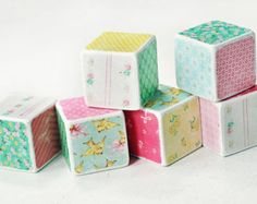 This is a set of six 2 inch blocks that have been painted white, and decorated with beautiful vintage shabby floral designs. Each block and the decorative paper has been lightly sanded for a distressed look. . Each block has been sealed with a protective, non-toxic varnish. *Please note that although these blocks have been constructed with non-toxic materials, they are not intended to be used as a toy and are strictly meant for decoration only.