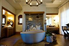 The large stone like bath is the perfect place for winding down after a hard day on set...