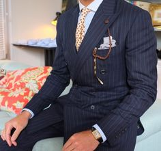 I am not crazy about pinstripe suits, but some of you might like it. I like the tie.