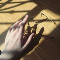 someone reaching for their glasses, brown, black, white Cool Stuff, Pretty Hands, Beautiful Hands, Kageyama, Haikyuu, Nate River, Blue Sargent, Hand Photography, Photography Aesthetic