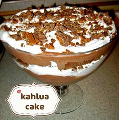 Choc. Cake-covered in 1/3 c. Kahlua, choc. mousse, cool whip, Skor/Heath candy pieces smashed