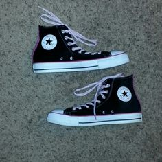 Converse High Tops Black with pink stripe and laces high tops there a velvet material that has been waterproof white trim around them good rubber soles Converse Shoes Athletic Shoes