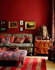 Living Room With Red Wall Colors And Ethnic Decor