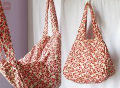 Bolsa artesanal, feita com tecido 100% algodão, linda estampa floral, para usar no ombro, fecha com zíper, tem dois bolsos laterais, e um bolso interno, ferragem prata. R$ 62,00