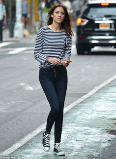 Contributing editor at Vogue Alexa Chung looked chic while strolling on the streets of NYC wearing a striped Breton top paired with skinny jeans and black and white Converse trainers. via dailymail.co.uk