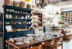"""""""A lot of people say they love how the store feels,"""" says Todd of the light-filled, high-ceilinged space, where curated cabinet displays and home accessories demonstrate their masterful eye for design. Fall Pumpkin Crafts, Fall Crafts, Diy Crafts, Nickey Kehoe, French Bistro Chairs, Green Rooms, Love Home, White Paints, One Kings Lane"""