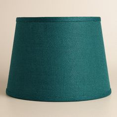 Soft light filters through our Teal Burlap Table Lamp Shade, illuminating the home with an ambient glow. This eco-chic shade is crafted of 100% burlap for a rustic look.