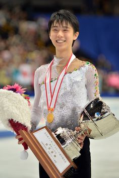 Yuzuru Hanyu of Japan poses with the trophy in the men's single victory ceremony after his victory during All Japan Figure Skating Championships at Saitama Super Arena on December 22, 2013 in Saitama, Japan.