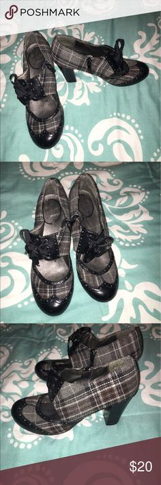 Black plaid heel Cute heels! Pairs great with business attire  or dress up a pair of dark jeans! Worn a few times still in good condition! If you have any questions just ask and I'm open to offers! Vigoss Shoes Heeled Boots