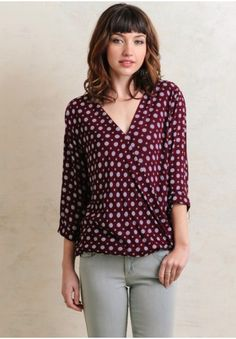 An oh-so-adorable addition to any ensemble, this burgundy top features an ornate floral print in hues navy, powder blue, and taupe. Designed with cuffed three-quarter sleeves and a surplice ...