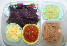 Mexican lunch--tortilla chips, refried beans, cheese, salsa, corn or tomatoes (instead of guac?)