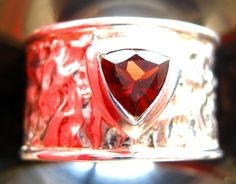 handcrafted sterling silver ring with trillion-cut Almandin gemstone.